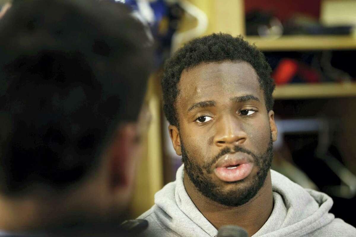 New York Giants Prince Amukamara talks to reporters in the team locker room in East Rutherford, N.J., Monday, Jan. 4, 2016. (AP Photo/Seth Wenig)