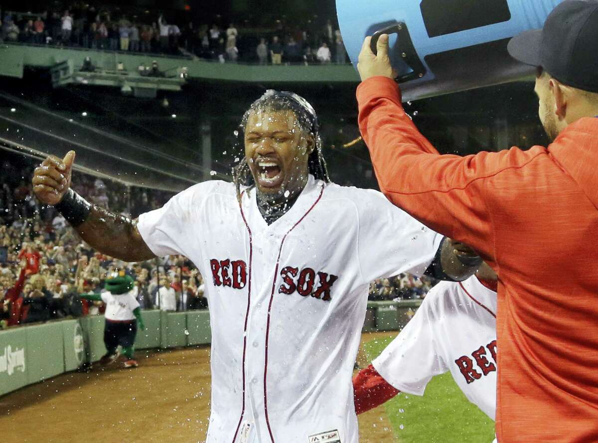 Hanley Ramirez is doused by teammates after he hit a three-run walk-off home run on Thursday.