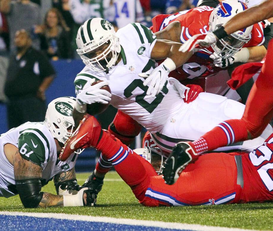 Jets running back Matt Forte (22) dives for a touchdown during the first half Thursday. Photo: Bill Wippert — The Associated Press  / FR170745 AP