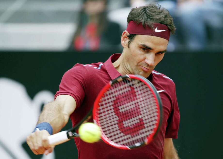 Roger Federer of Switzerland returns the ball to Dominic Thiem of Austria during their match at the Italian Open tennis tournament, in Rome, Thursday, May 12, 2016. (AP Photo/Andrew Medichini) Photo: AP / Copyright 2016 The Associated Press. All rights reserved. This material may not be published, broadcast, rewritten or redistribu