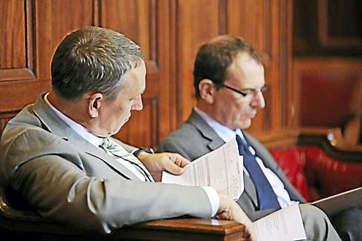 Gian-Carl Casa sits with OPM Secretary Ben Barnes in the state Senate in May.