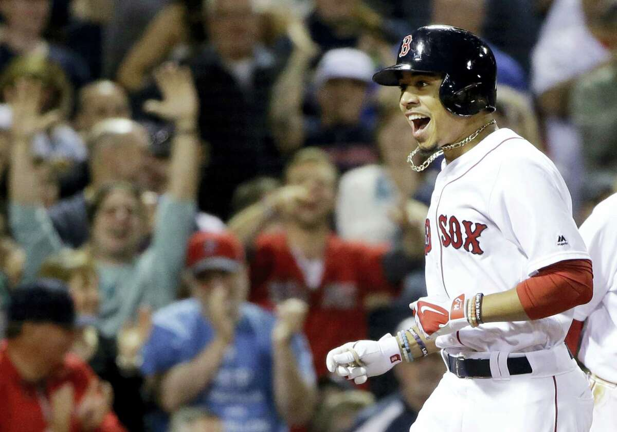 Boston Red Sox's Mookie Betts celebrates after hitting a three-run homer against the Houston Astros in the sixth inning of a baseball game at Fenway Park, Thursday, May 12, 2016, in Boston. (AP Photo/Elise Amendola)