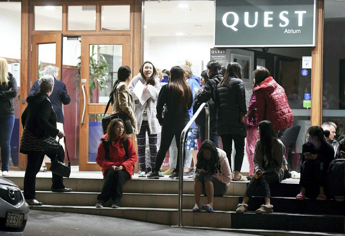 People evacuated from the Quest On the Terrace Hotel gather outside the hotel in Wellington after a 6.6 earthquake based around Cheviot in the South island shock the capital, New Zealand on Nov. 14, 2016. A powerful earthquake struck New Zealand near the city of Christchurch early Monday, with strong jolts causing some damage to buildings over 200 kilometers (120 miles) away in the capital, Wellington.