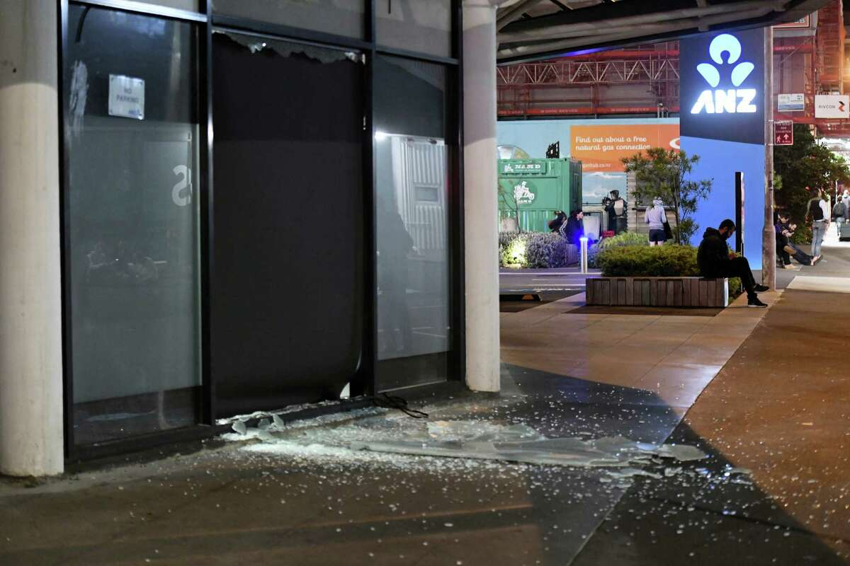 A broken window is seen in Tory Street after people were evacuated from the building in Wellington after a 6.6 earthquake based around Cheviot in the South island shock the capital, New Zealand on Nov. 14, 2016. A powerful earthquake struck New Zealand near the city of Christchurch early Monday, with strong jolts causing some damage to buildings over 200 kilometers (120 miles) away in the capital, Wellington.