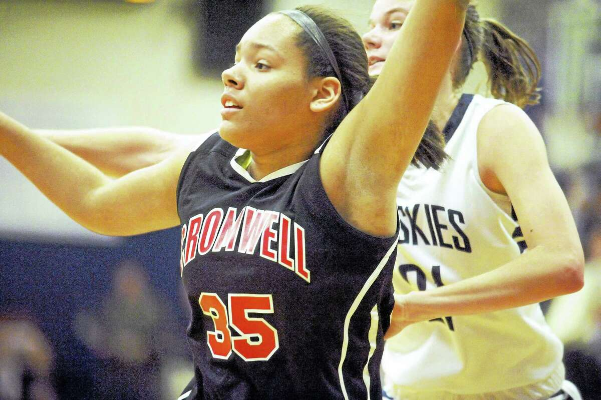 Cromwell's Geanna Williams and Morgan's Josie Sullivan battle for position in the low post Thursday in Clinton.