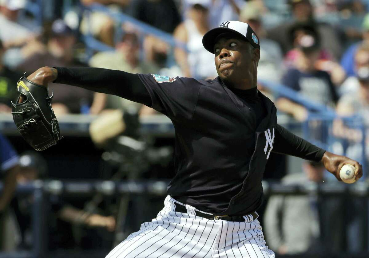 New York Yankees relief pitcher Aroldis Chapman goes into his windup against the Toronto Blue Jays during the fifth inning of a spring training baseball game Thursday, March 10, 2016, in Tampa, Fla. (AP Photo/Chris O'Meara)