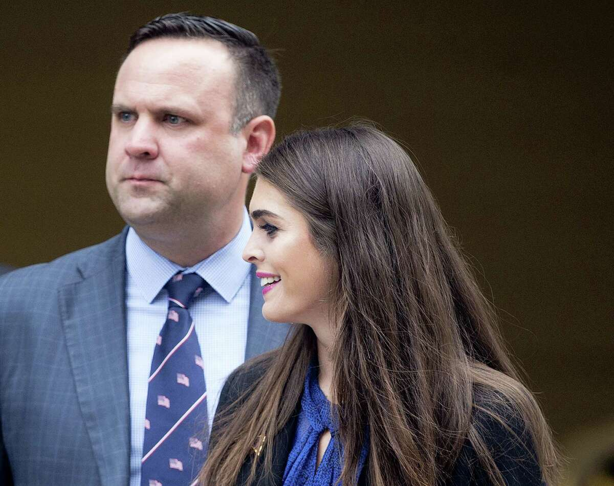 In this May 12, 2016, file photo, Republican presidential candidate Donald Trump's campaign communications manager Hope Hicks, right, and Daniel Scavino Jr., Director for Social Media for Trump Campaign walk to their motorcade vehicle after Trump's visit to Jones Day's D.C. law offices in Washington. The Associated Press reported last month that Trump requires nearly everyone in his campaign and businesses to sign legally binding nondisclosure agreements prohibiting them from releasing any confidential or disparaging information about the real estate mogul, his family or his companies. Trump has also said he would consider requiring such agreements in the White House.