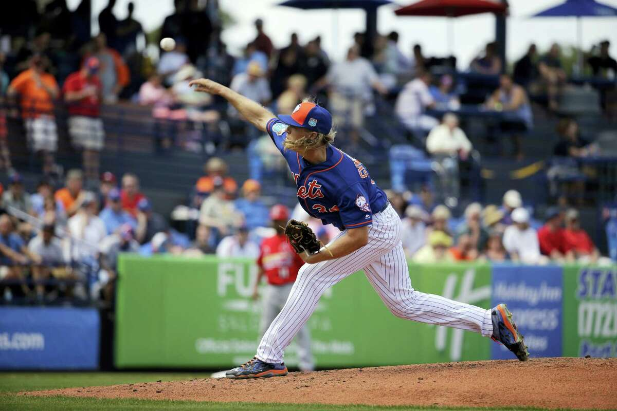 New York Mets starting pitcher Noah Syndergaard throws during the second inning of an exhibition spring training baseball game against the St. Louis Cardinals Thursday, March 10, 2016, in Port St. Lucie, Fla. (AP Photo/Jeff Roberson)