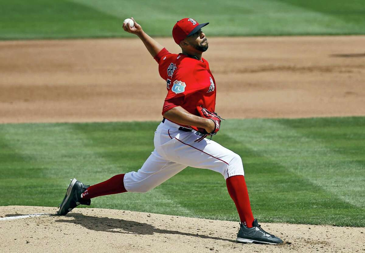 Boston Red Sox starting pitcher David Price throws to the Minnesota Twins in the third inning of a spring training baseball game in Fort Myers, Fla., Thursday, March 10, 2016. (AP Photo/Patrick Semansky)
