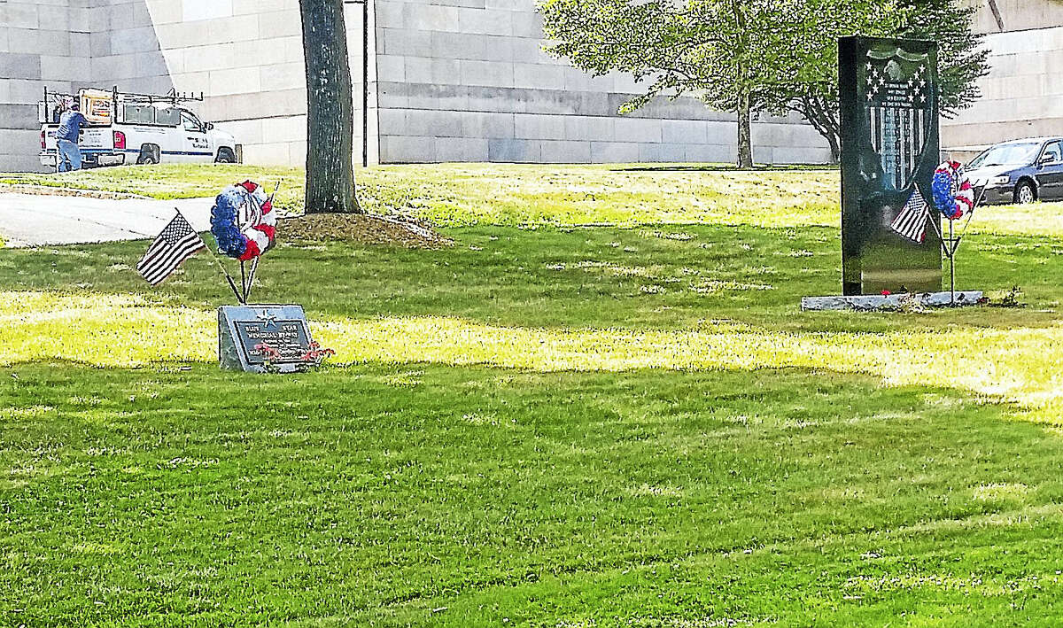 Kathleen Schassler — The Middletown Press The Disabled Americans Veterans for Life Memorial will be placed next to the Vietnam War Veterans Memorial, right, where currently a marker wreath is placed on Veteran's Green.
