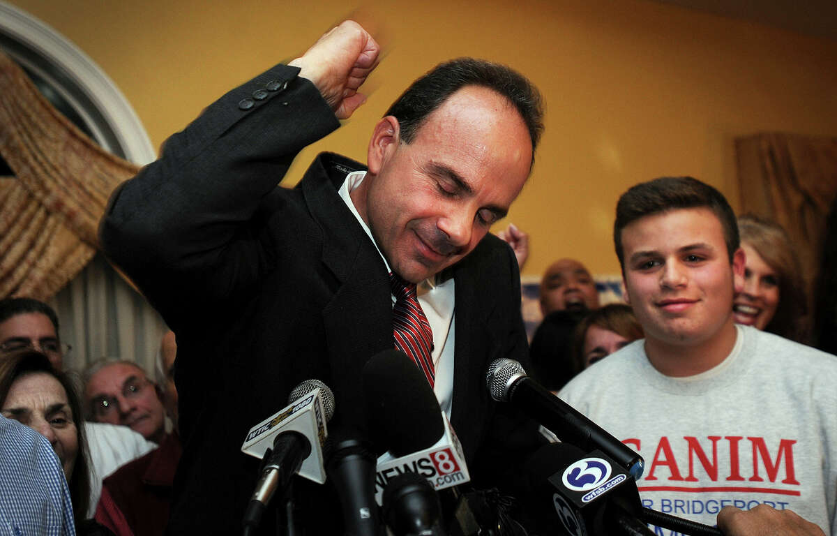 Democrat Joe Ganim celebrates with his son Rob and other supporters after winning the election as Bridgeport's new mayor, Tuesday, Nov. 3, 2015.