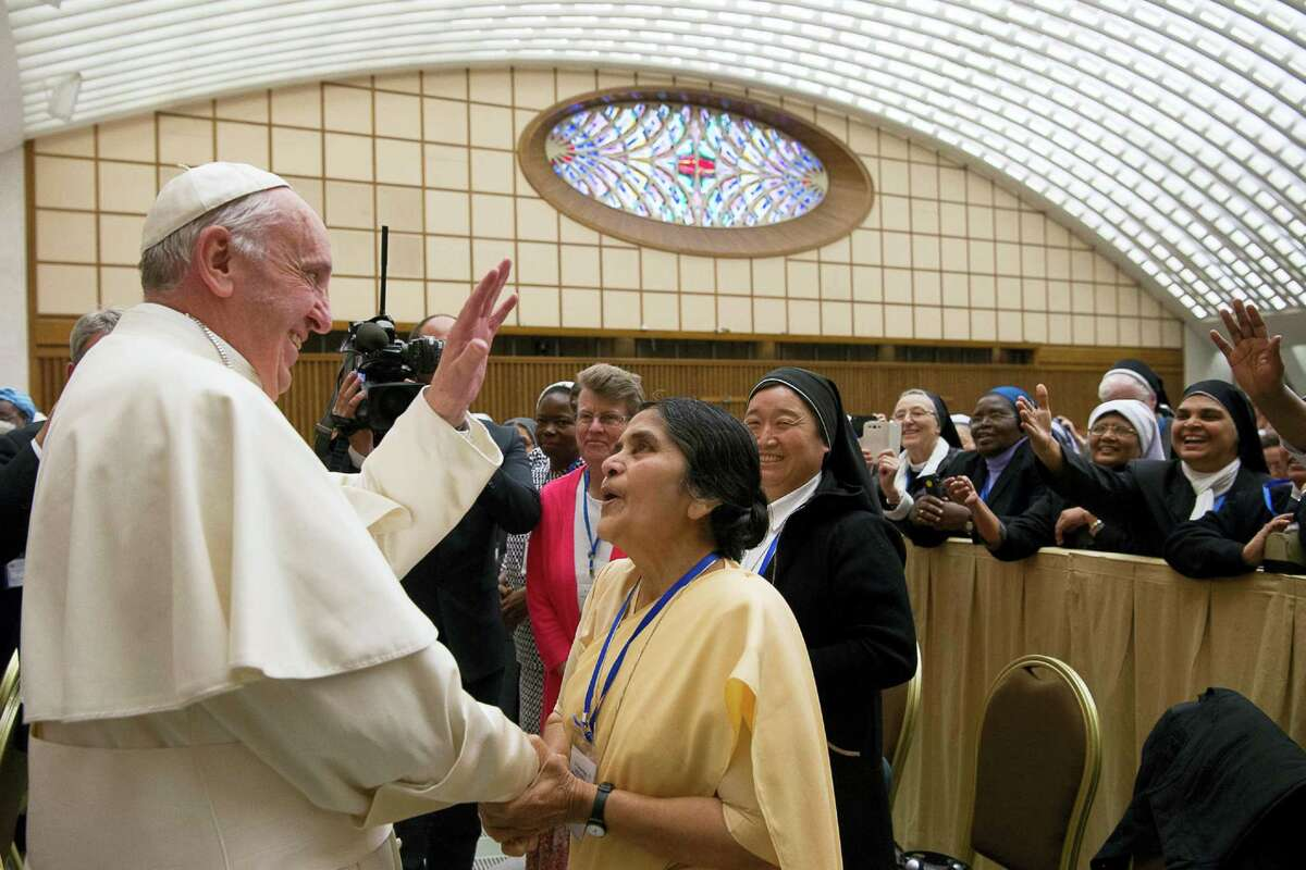 Pope Francis greets participants in a special audience with members of the International Union of Superiors General in the Paul VI hall at the Vatican, Thursday, May 12, 2016. Pope Francis said Thursday he is willing to create a commission to study whether women can be deacons in the Catholic Church, signaling an openness to letting women serve in ordained ministry currently reserved to men.