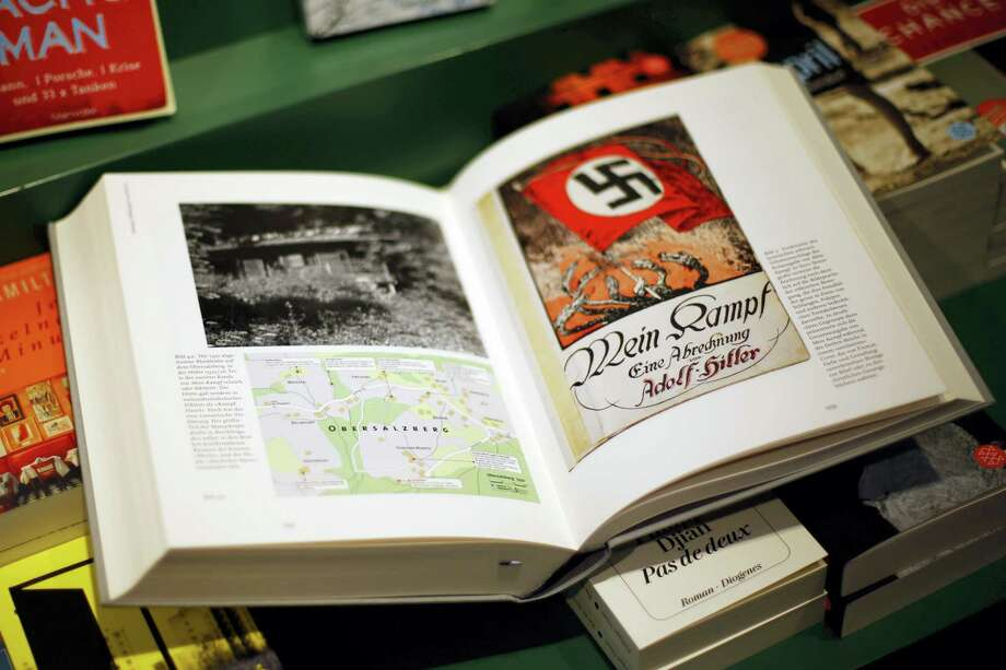 """A copy of """"Hitler, Mein Kampf – A critical edition"""" lies on a display table in a book shop in Munich, Germany,  Friday, Jan. 8, 2016. The annotated edition of """"Mein Kampf"""" is the first version of Adolf Hitler's notorious manifesto to be published in Germany since the end of World War II. Photo: AP Photo/Matthias Schrader   / AP"""