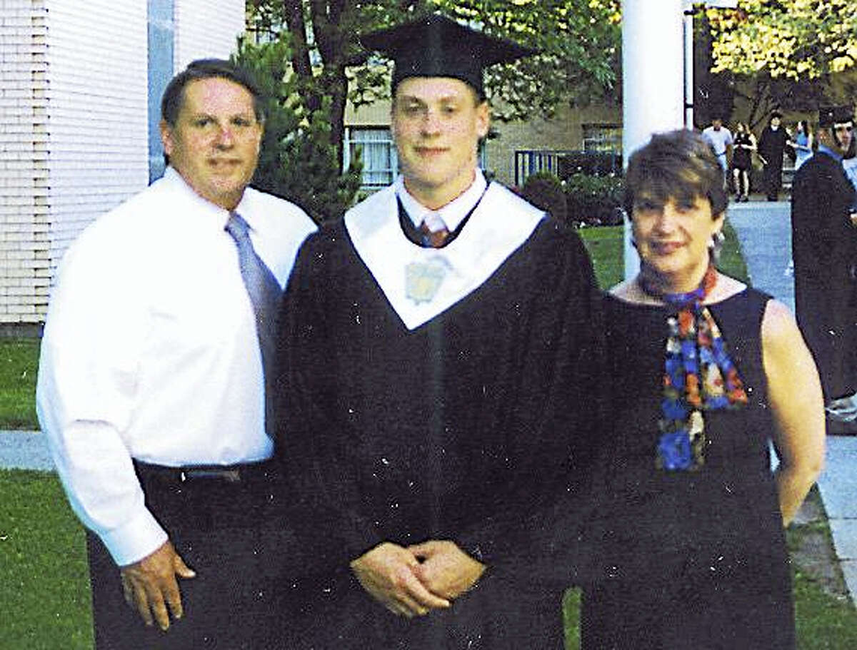 Kyle Eagleson stands with his parents Bruce and Gail Eagleson after Kyle's graduation from Xavier High School in 1999. His father, who was working on the 17th floor of the World Trade Center in New York City on Sept. 11, 2001, was killed when United Flight 175 crashed into the South Tower.