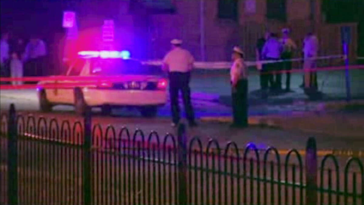 In this frame from video, police work at the scene of a shooting on Wednesday, Sept. 14, 2016, in Columbus, Ohio. Police in Ohio responding to a report of an armed robbery shot and killed a boy who they said pulled a gun from his waistband that was later determined to be a BB gun.