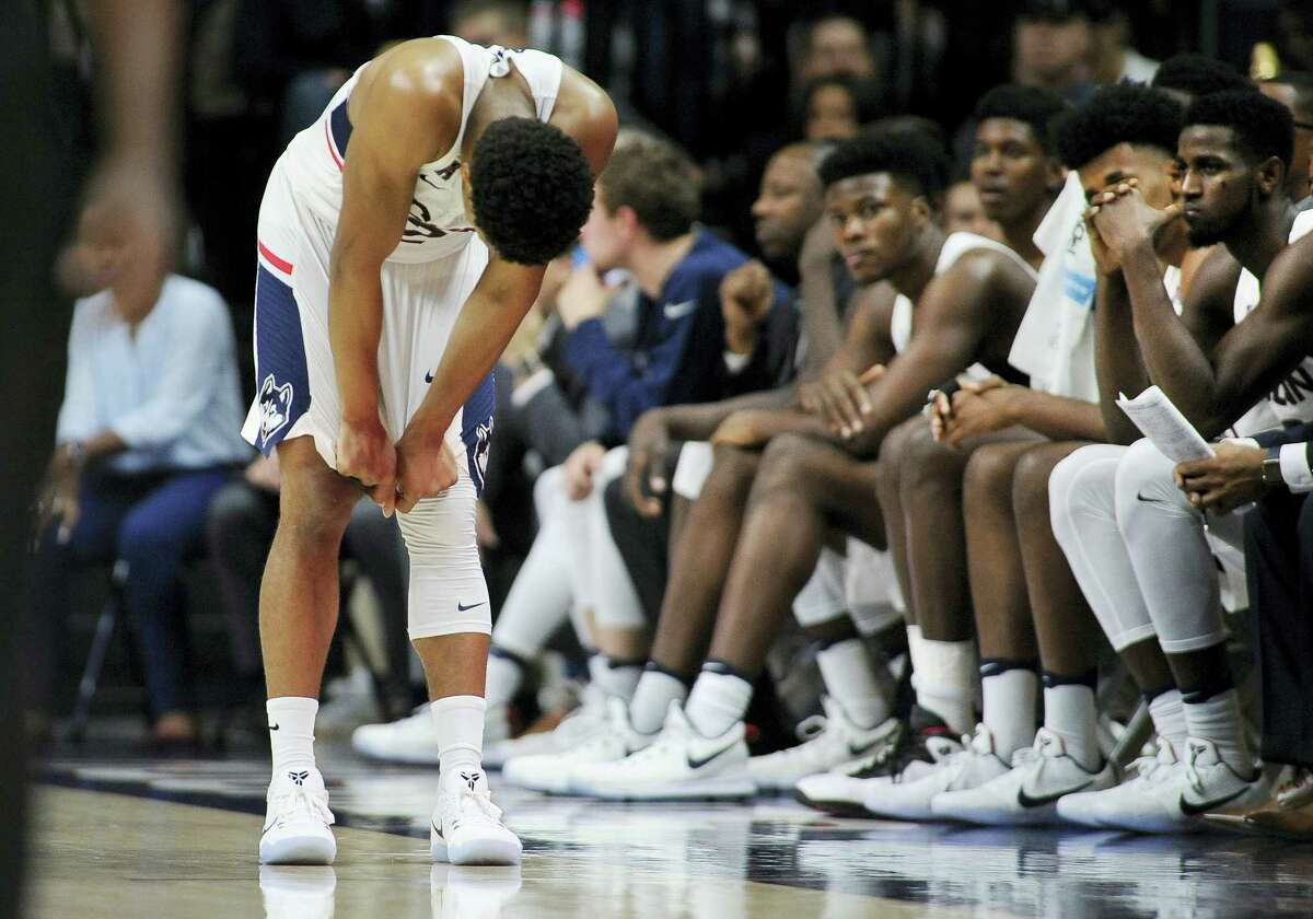 Connecticut's Jalen Adams reacts in the final minutes of the team's 67-58 loss against Wagner Friday at Gampel Pavilion in Storrs.