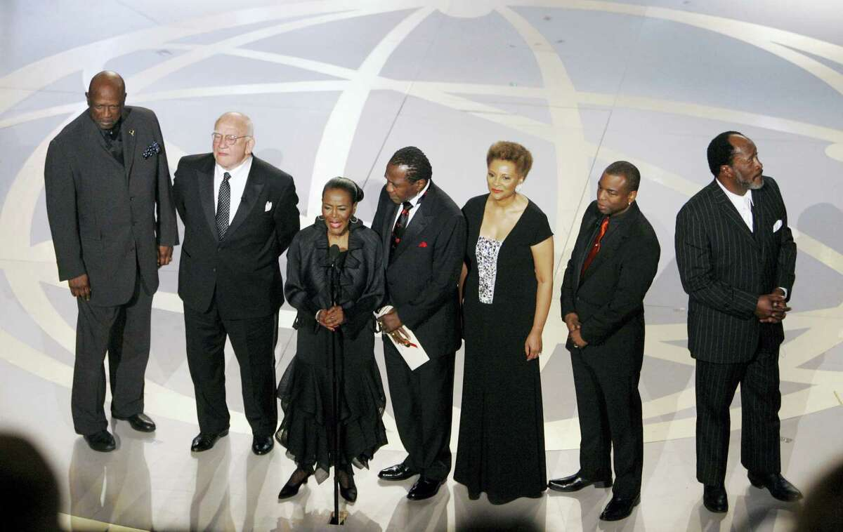"""In this Sept. 16, 2007, file photo, """"Roots"""" cast members from left, Louis Gossett Jr., Edward Asner, Cicely Tyson, Ben Vereen, Leslie Uggams, LaVar Burton and John Amos participate in a tribute to """"Roots"""" during the 59th Primetime Emmy Awards in Los Angeles. In time for its 40th anniversary next year, """"Roots: The Complete Original Series"""" is being re-released June 7, 2016, on Blu-ray by Warner Bros."""