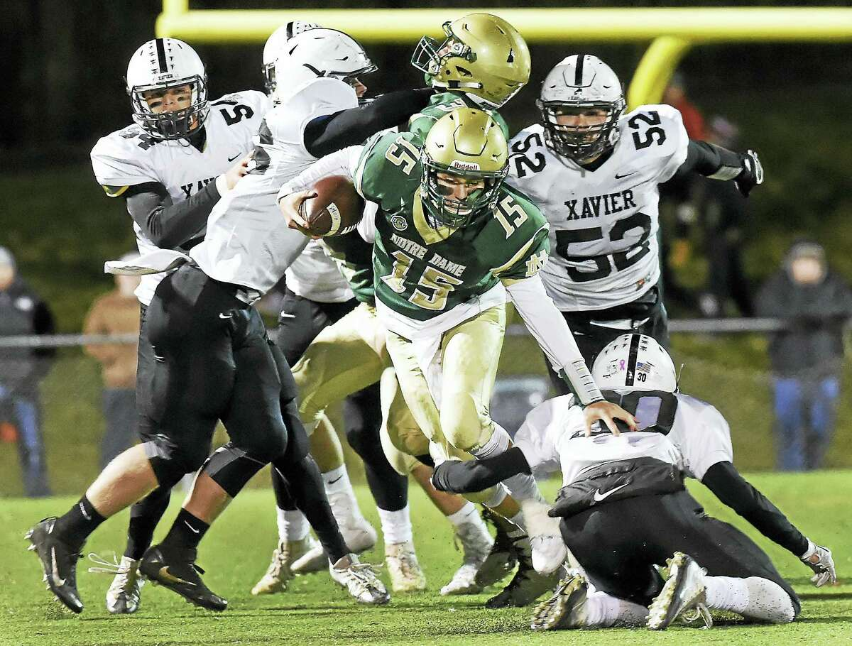 Notre Dame quarterback Christopher Elias breaks through the Xavier defense in 20-0 win for the Green Knights, Friday, November 11, 2016, at Veterans Stadium in West Haven. (Catherine Avalone/New Haven Register)