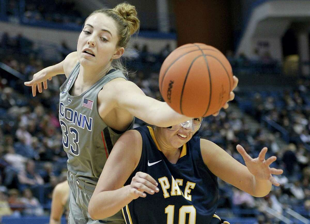 Connecticut's Katie Lou Samuelson, left, reaches beyond Pace's Gabriella Rubin to grab a rebound in the second half of a preseason NCAA college basketball game, Sunday, Nov. 6, 2016, in Hartford, Conn. (AP Photo/Jessica Hill)
