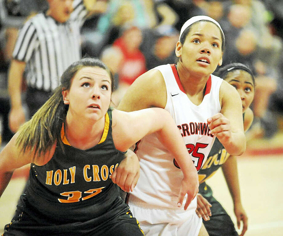 Holy Cross senior Caitlin Cipriano, left, and Cromwell junior Geanna Williams battle for the rebound during Friday's Class M state semifinal at Berlin High School. Photo: Jimmy Zanor - The Middletown Press