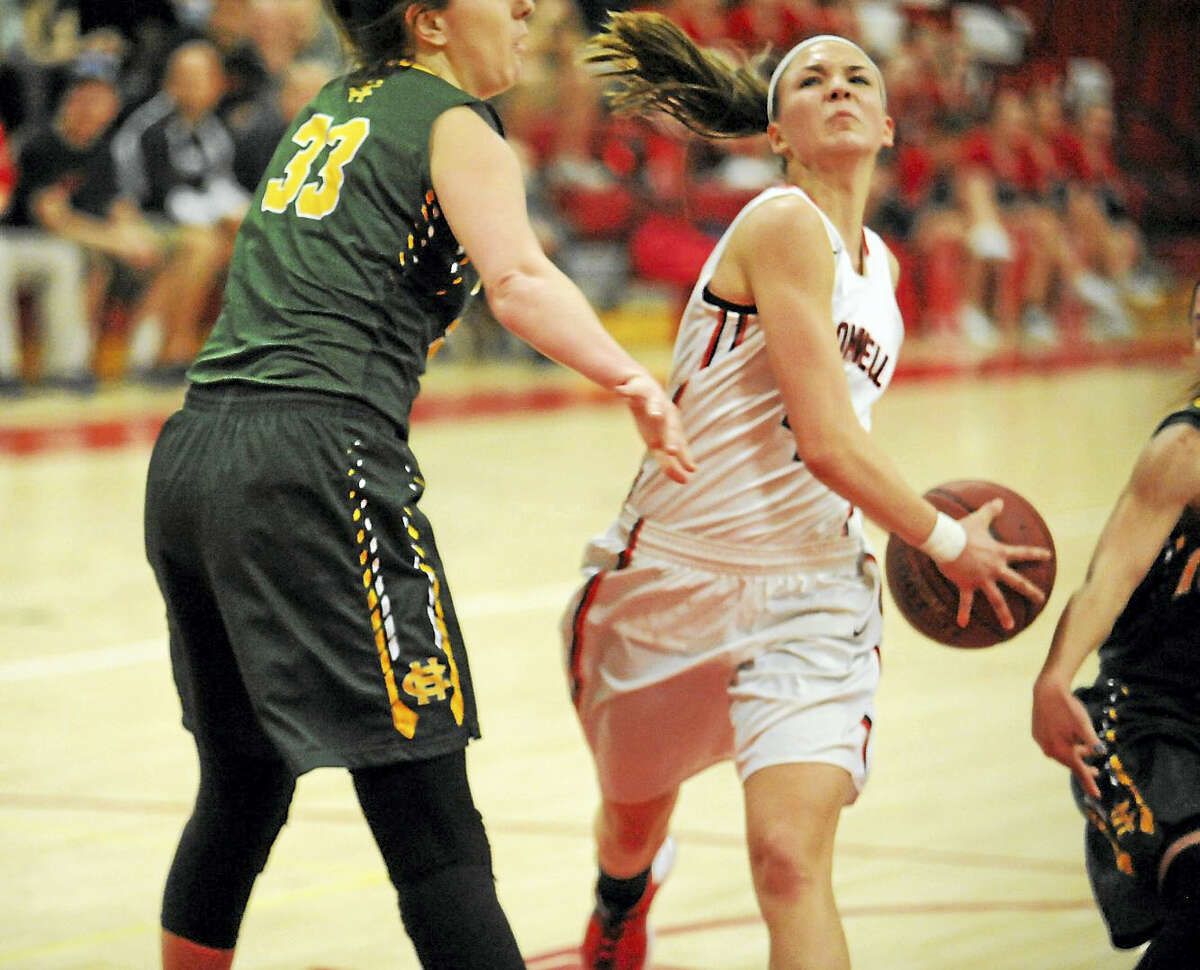 Cromwell junior Nikki Bitinaitis drives through the lane against Holy Cross. The Panthers topped the Crusaders, 58-46.