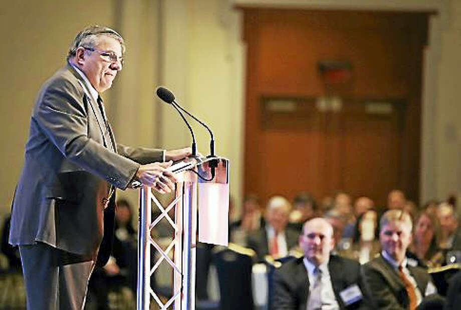 Nick Perna, an economist with Webster Bank, addresses business executives at CBIA's Economic Summit and Outlook event. Photo: Christine Stuart — Ctnewsjunkie.com