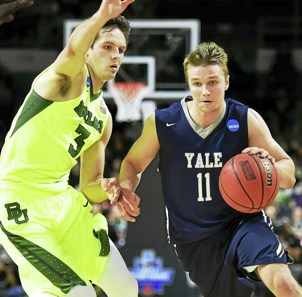 Yale's Makai Mason drives to the hoop as Baylor's Alex Copeland defends in the 79-75 victory for the Bulldogs in the first round of the 2016 NCAA Men's Basketball Tournament at the Dunkin' Donuts Center in Providence, RI. (Catherine Avalone/New Haven Register)
