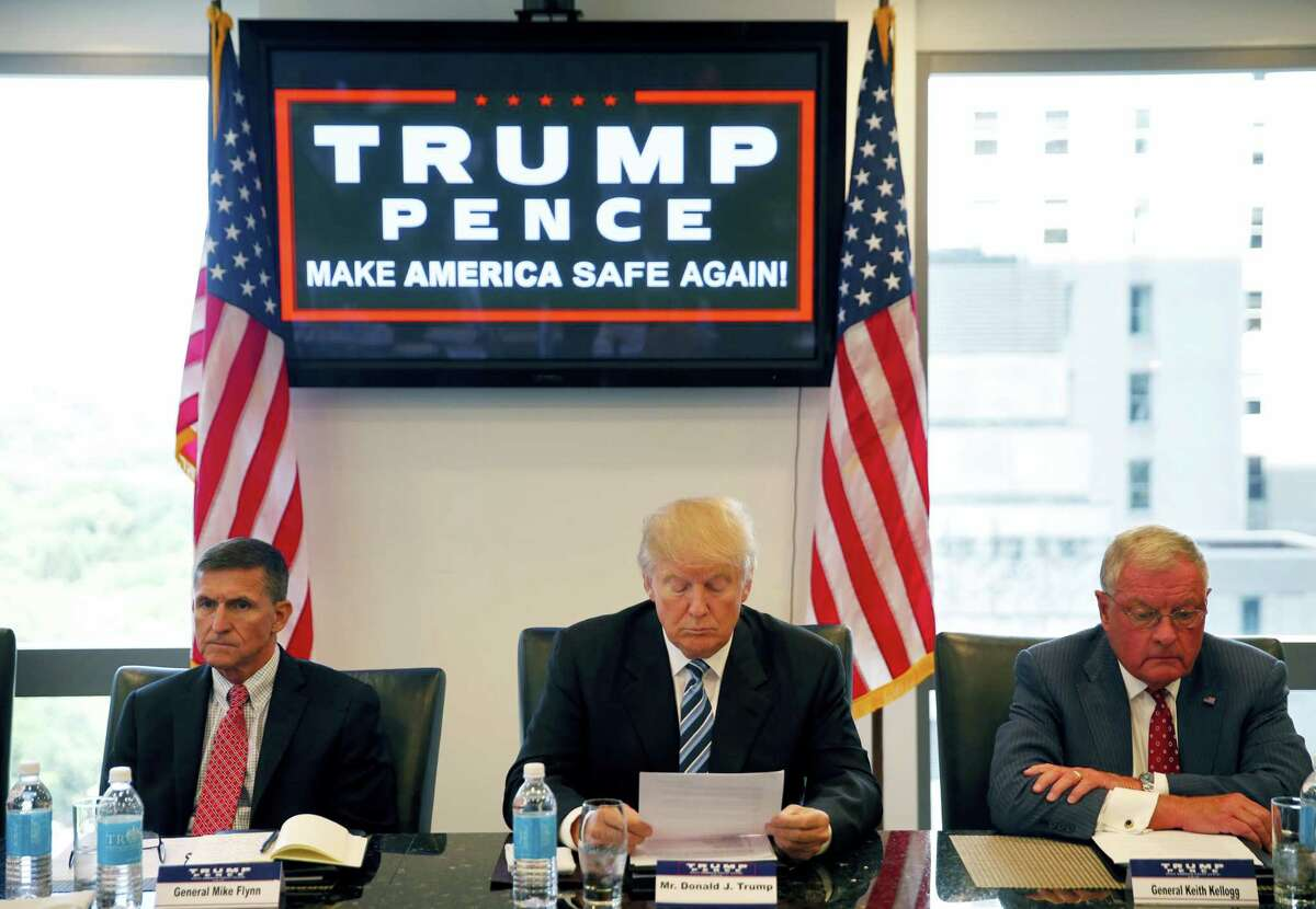 In this Aug. 17, 2016, file photo, then-Republican presidential candidate Donald Trump participates in a roundtable discussion on national security in his offices in Trump Tower in New York, with Ret. Army Gen. Mike Flynn, left, Ret. Army Lt. Gen. Keith Kellogg. Trump'Äôs transition team is rich with lobbyists, a climate change-denier and an ex-federal prosecutor involved in the mass firings of U.S. attorneys. Kellogg has been working closely with Trump adviser Flynn, advising the Trump campaign on matters relating to foreign policy and national security.