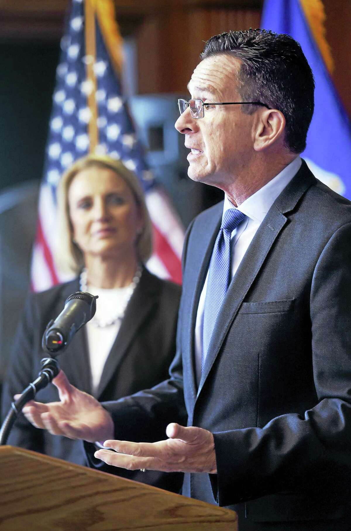 Gov. Dannel Malloy discusses affordable housing at a press conference at the West Village Apartments in New Haven Friday. In the background is state Department of Housing Commissioner Evonne Klein.