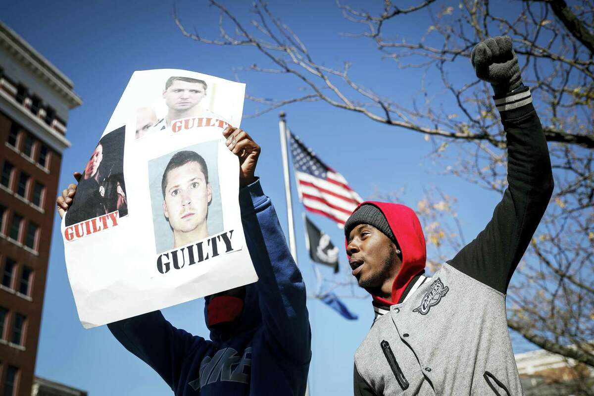 Protestors chant outside the Hamilton County Courthouse after a mistrial is declared due to a hung jury in the murder trial against Ray Tensing, Saturday, Nov. 12, 2016, in Cincinnati. Tensing, a white former University of Cincinnati police officer, is charged with murder in the shooting of Sam DuBose, an unarmed black motorist, while on duty during a routine traffic stop on July 19, 2015.