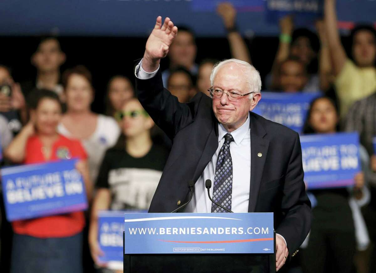 Democratic presidential candidate, Sen. Bernie Sanders, I-Vt., waves to his supporters at a campaign rally Tuesday in Miami.