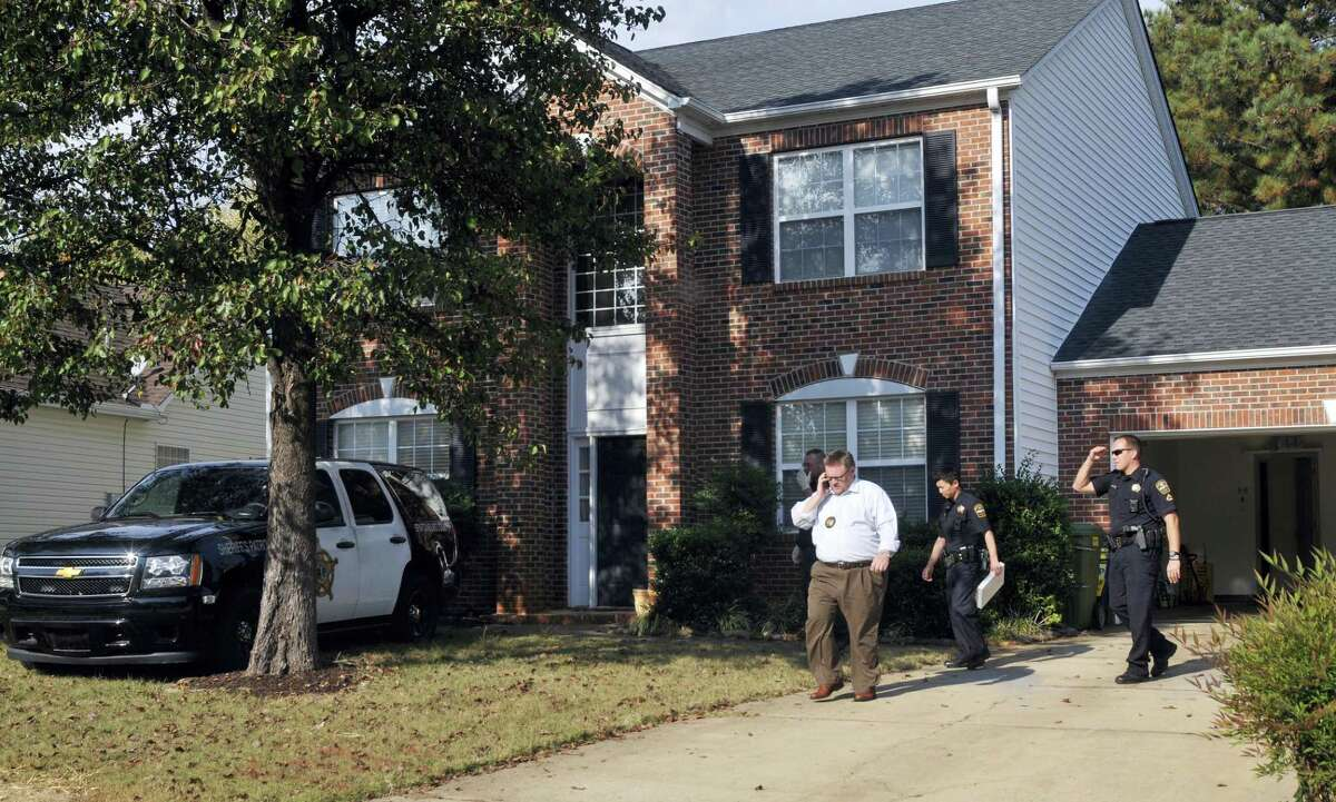 In this Thursday, Nov. 3, 2016, file photo, registered sex offender Todd Christopher Kohlhepp's home is searched by Spartanburg County Sheriff's deputies and his vehicles are impounded in Moore, S.C., after he was arrested earlier in the day. Kohlhepp, accused of seven killings in South Carolina, built a successful real-estate firm but displayed odd behavior. People who knew or worked with him said he watched pornographic videos during work and openly discussed that he was a registered sex offender.