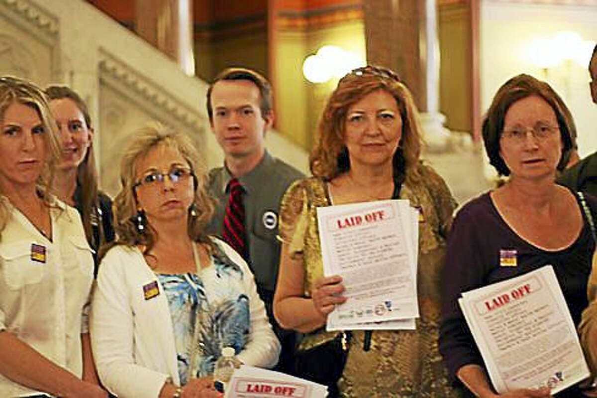 Union employees gather outside the state Senate chambers Thursday.