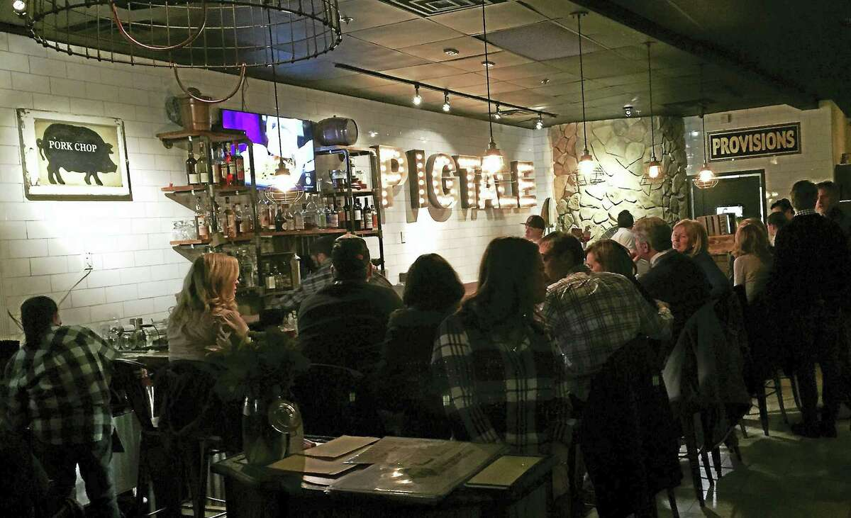The bar area is almost half the entire size of Pig Tale Farm To Wood-Fired Oven restaurant in Nashua, New Hampshire.