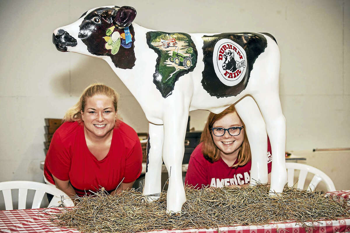 """Local artist Aleta Guldeski (not pictured) painted """"Buttercup"""" the calf to commemorate the 100th anniversary of The Durham Fair. The artistic creation depicts events and exhibits at the fair."""