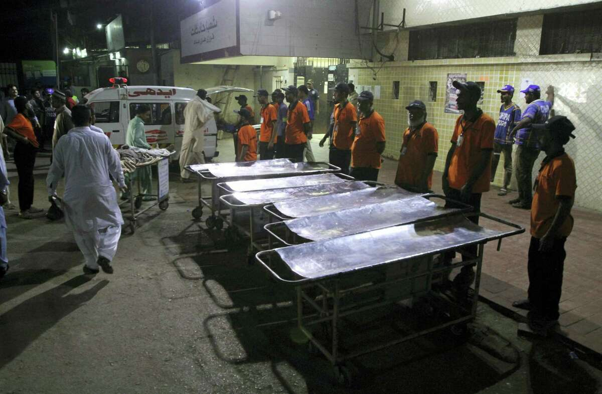 Staff members of a local hospital wait for casualties of bomb blast at a Sufi shrine, in Karachi, Pakistan, Saturday, Nov. 12, 2016. Pakistani police say a bomb blast at a Sufi shrine has killed several people and wounded many others in the country's southwest. Sarfaraz Bugti, home minister for Baluchistan province, confirmed that the blast occurred with hundreds in attendance at the shrine of Sufi saint Shah Bilal Noorani.