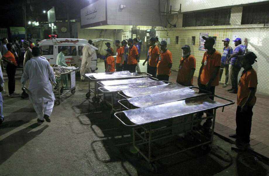 Staff members of a local hospital wait for casualties of bomb blast at a Sufi shrine, in Karachi, Pakistan, Saturday, Nov. 12, 2016. Pakistani police say a bomb blast at a Sufi shrine has killed several people and wounded many others in the country's southwest. Sarfaraz Bugti, home minister for Baluchistan province, confirmed that the blast occurred with hundreds in attendance at the shrine of Sufi saint Shah Bilal Noorani. Photo: Fareed Khan — AP Photo  / Copyright 2016 The Associated Press. All rights reserved.