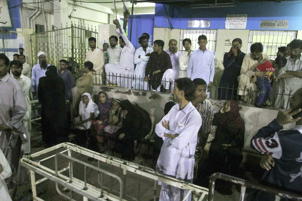 People gather outside an emergency ward of a local hospital after hearing news of a bomb blast at a Sufi shrine, in Karachi, Pakistan, Saturday, Nov. 12, 2016. Pakistani police say a bomb blast at a Sufi shrine has killed several people and wounded many others in the country's southwest. Sarfaraz Bugti, home minister for Baluchistan province, confirmed that the blast occurred with hundreds in attendance at the shrine of Sufi saint Shah Bilal Noorani.