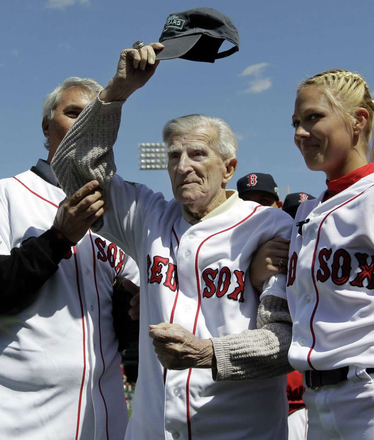 In this April 13, 2012 photo, Boston Red Sox great Johnny Pesky tips his cap to the fans prior to Boston's home opener baseball game against the Tampa Bay Rays at Fenway Park in Boston. Pesky died in Danvers, Mass. at 92.