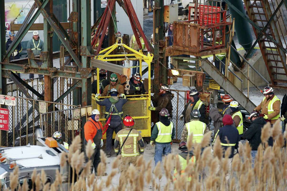 The fourth group of workers emerge from an elevator Thursday, Jan. 7, 2016, after they were stuck overnight in a shaft at the Cayuga Salt Mine in Lansing, N.Y. Cargill Inc. spokesman Mark Klein said all 17 miners have been rescued.