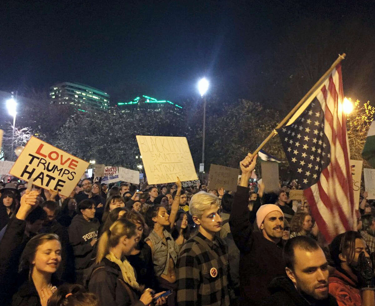 Protesters march on their way to Waterfront Park in Portland, Ore., on the third day of protests over the results of the 2016 U.S. presidential election, Thursday, Nov. 10, 2016. President-elect Donald Trump fired back on social media after demonstrators in both red and blue states hit the streets for another round of protests, showing outrage over the Republican's unexpected win.