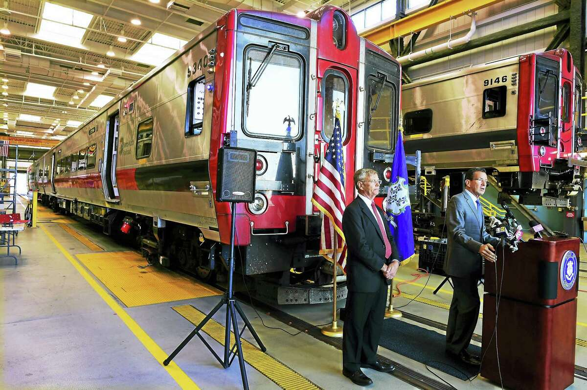 Gov. Dannel P. Malloy, right, and Connecticut Department of Transportation Commissioner James P. Redeker announce the purchase of 60 M8 rail cars for the New Haven Line operated by Metro-North Railroad, during a press conference Tuesday at the New Haven Rail Yard on Brewery Street. Of the 60 new rail cars, 10 will be bar cars.