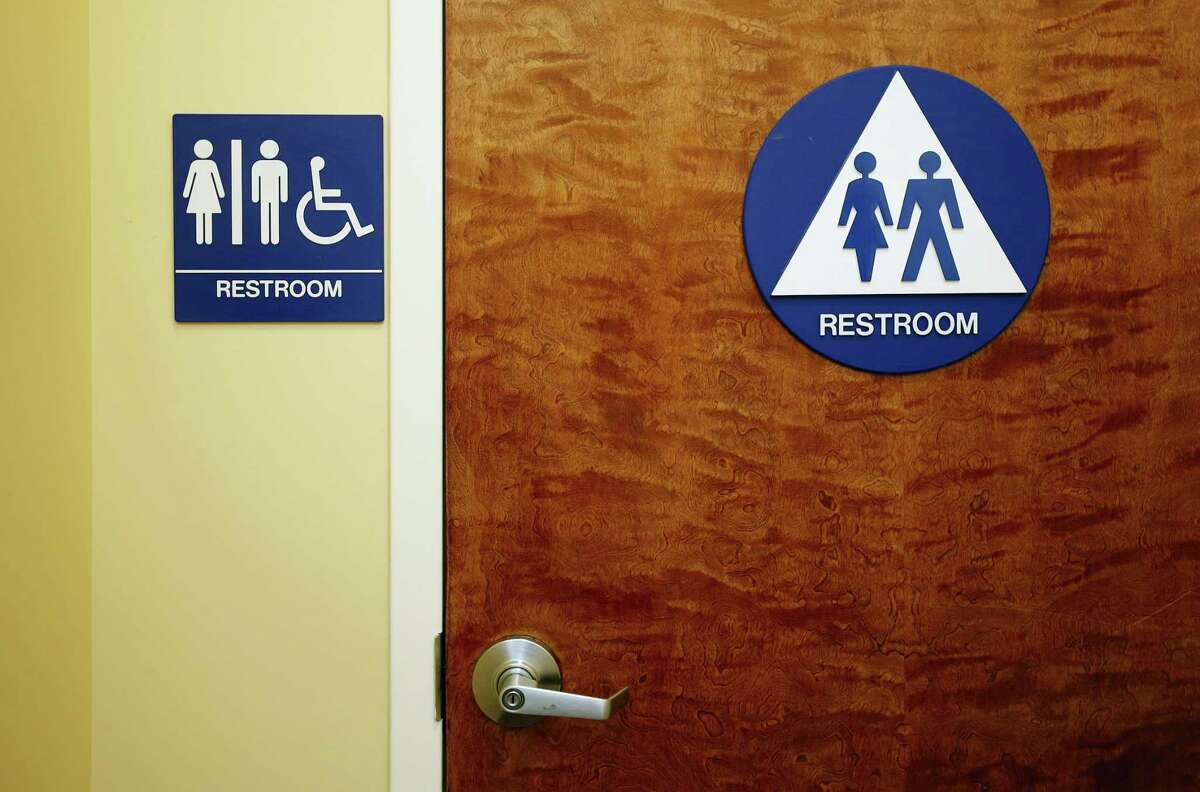A gender neutral restroom is seen at the Downtown & Vine Restaurant and Wine Bar, Monday, May 9, 2016, in Sacramento, Calif.