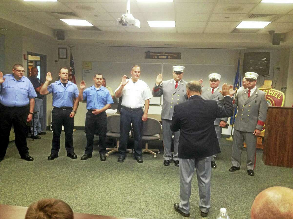 Seven men were promoted or renewed their pledges to firefighting in Cromwell on Monday: Deputy Chief Michael Salonia, Assistant Chief Fire D.J. Zordan, Assistant Chief EMS Rob McIntyre, Lt. Michael Zadrick, firefighter Brandon Hinds, firefighter Conner Johnson and EMS paramedic Robert Ferone.