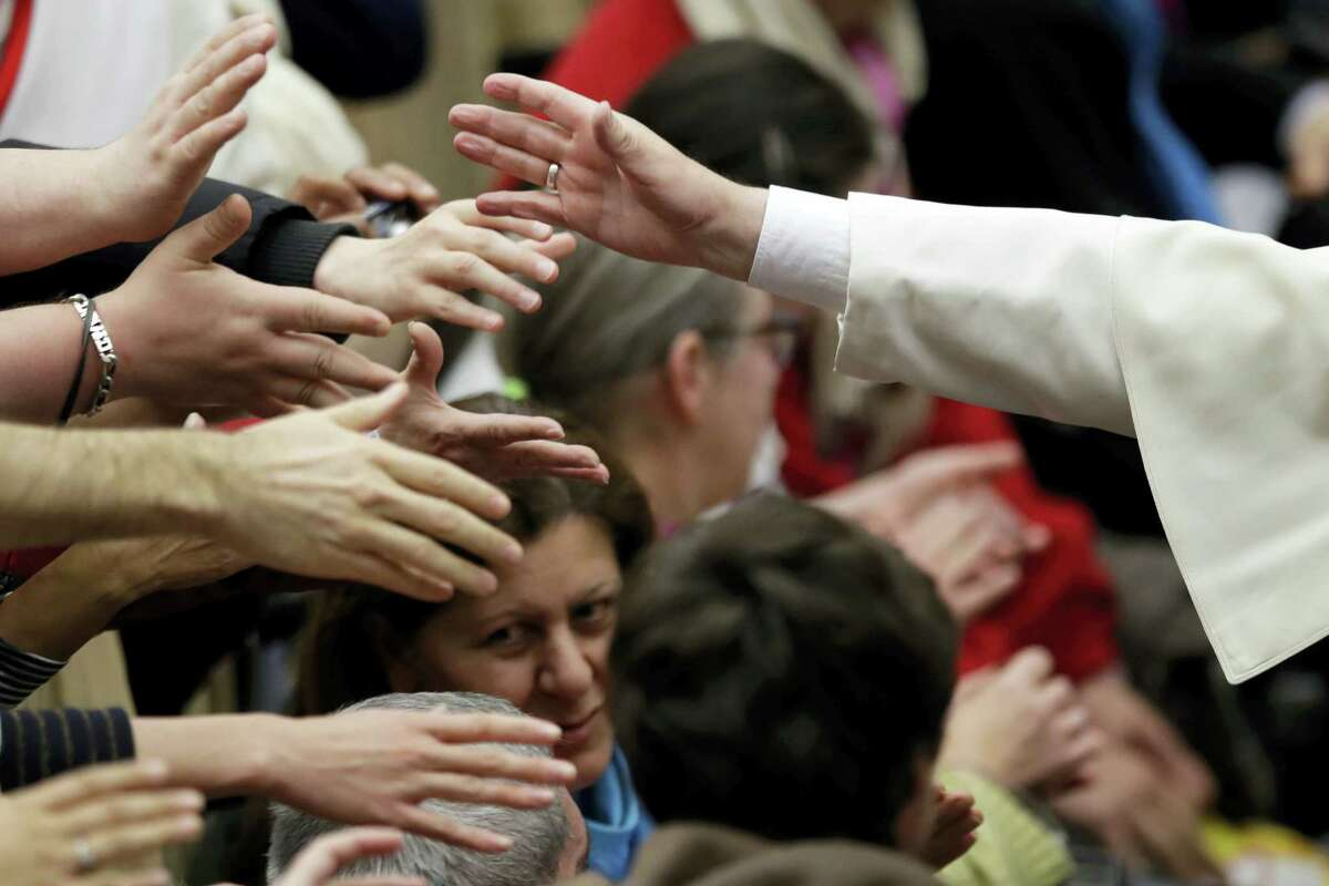 Pope Francis blesses faithful during an audience with the participants of homeless jubilee in the Paul VI Hall at the Vatican, Friday, Nov. 11, 2016.