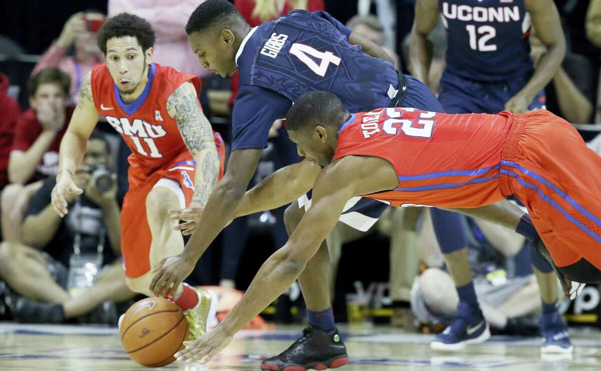 Connecticut guard Sterling Gibbs (4) chases the loose ball against SMU defenders Nic Moore (11) and Jordan Tolbert (23) during the first half of an NCAA college basketball game Thursday, March 3, 2016, in Dallas. (AP Photo/LM Otero)