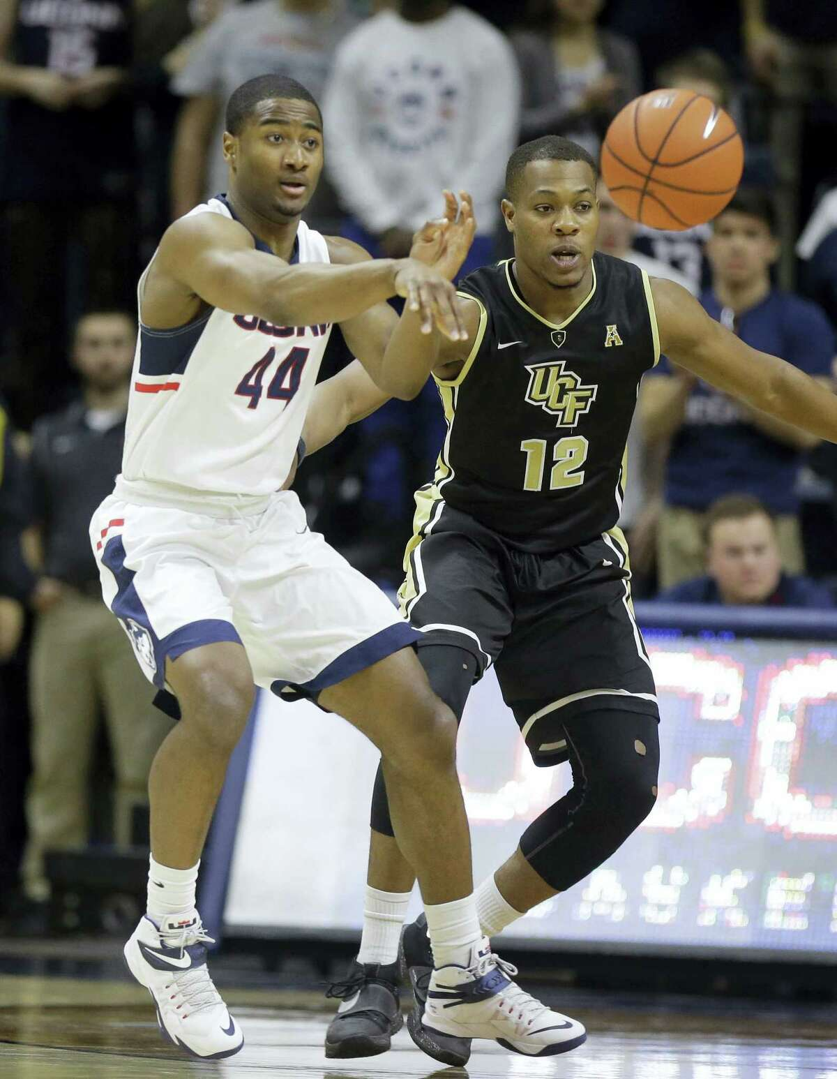 Connecticut's Rodney Purvis (44) passes the ball as Central Florida's Matt Williams (12) looks on in the first half of an NCAA college basketball game Sunday, March 6, 2016, in Storrs, Conn. (AP Photo/Steven Senne)