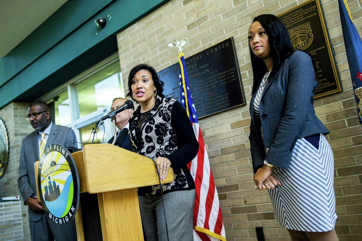 Flint Mayor Karen Weaver tells reporters that an estimated 50 homes have had lead pipes removed and replaced in the second phase of Weaver's Fast Start program, during a press conference on Monday at City Hall in Flint, Mich.