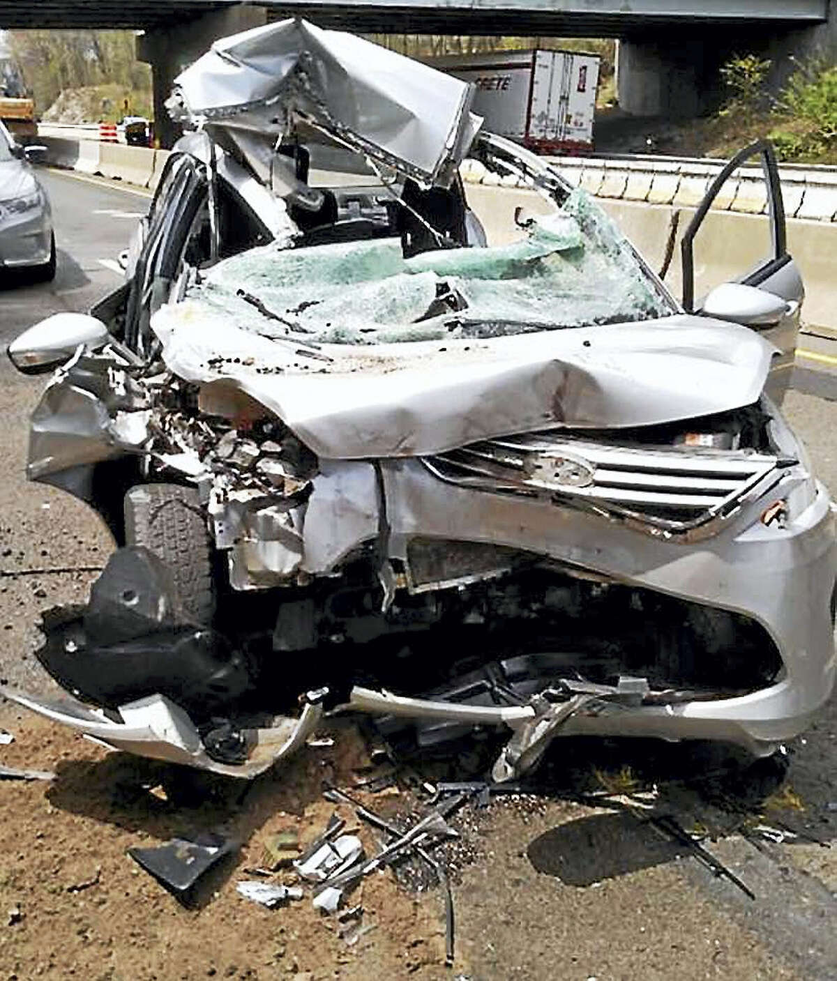 Two people were taken to the hospital Tuesday after a car crashed into a state Department of Transportation construction truck on Interstate 95 in Old Lyme.
