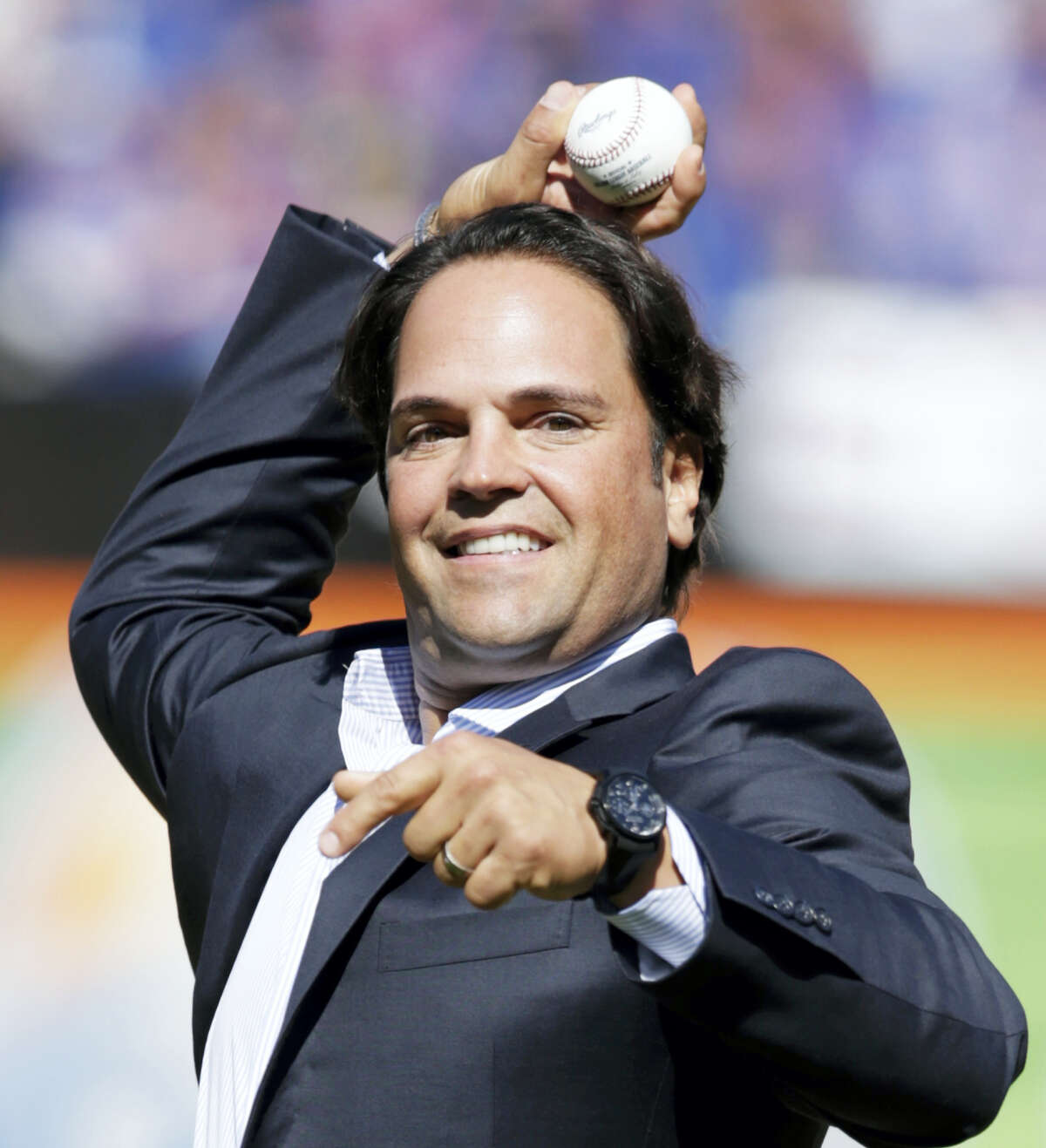 FILE - In this Sept. 29, 2013, file photo, former New York Mets catcher Mike Piazza throws out the ceremonial first pitch before a baseball game against the Milwaukee Brewers, following a ceremony inducting him into the Mets Hall of Fame, in New York. Ken Griffey Jr. seems assured of election to the Baseball hall of Fame on the first try Wednesday, Jan. 6, 2016, possibly with a record vote of close to 100 percent. Mike Piazza, Jeff Bagwell and Tim Raines also were strong candidates to gain the 75 percent needed for baseball's highest honor.(AP Photo/Kathy Willens, File)